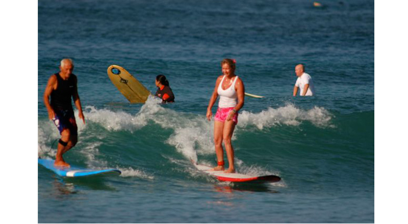6497331c87 Any age can learn to surf and relax in warm gentle waves in Oahu Hawaii