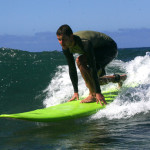 A Russian visitor leaning how to surf in a 5 day surf clinic on Oahu