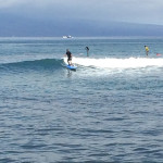 Learning to Surf in Maui, Hawaii on his 1st wave ever!